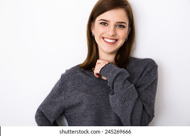 Portrait of a cheerful young woman over gray background
