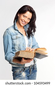 Portrait of a cheerful young woman reading a book