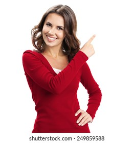 Portrait of cheerful young woman showing copyspace, visual imaginary or something, or pressing virual button, isolated over white background