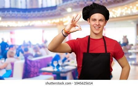 Portrait Of Chef Gesturing, Indoors