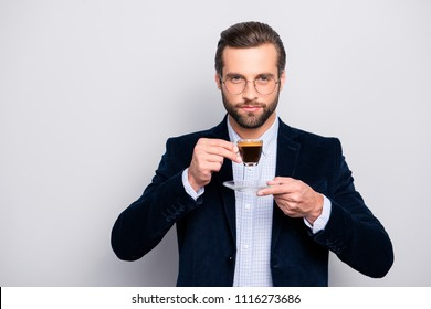 Portrait of chic handsome pleased delightful serious attractive dreamy wealthy elegant classy man smelling the aroma of fresh bitter coffee isolated on gray background copy-space