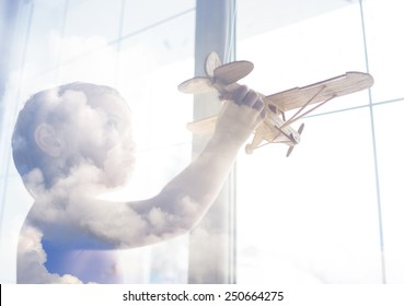 Portrait of child with airplane traveling toy in double exposure