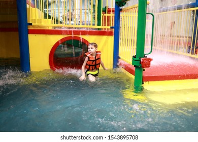 Portrait of child in the amusement pool