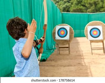 portrait of a child, archery, rear view