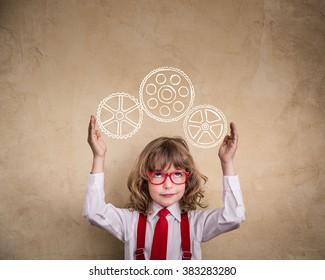 Portrait of child businessman in office. Smart kid in class