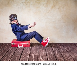 Portrait of child businessman in office. Travel and summer vacation business concept