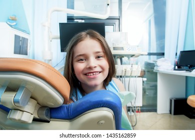 A portrait of a child girl in the cabinet of a dentist. treatment, medicine, hospital.