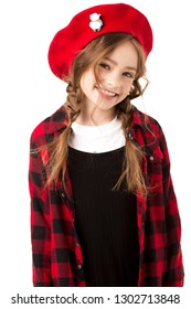 Portrait of a child. The girl smiles broadly. Bright clothes, red.