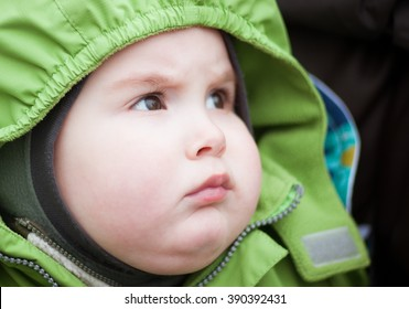 Portrait of a child in a green hood