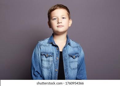 portrait of child. handsome little boy in jeans wear. 11 years old kid