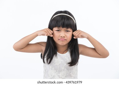 Portrait of a child making sad face on white background