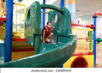Portrait of child on a water slide