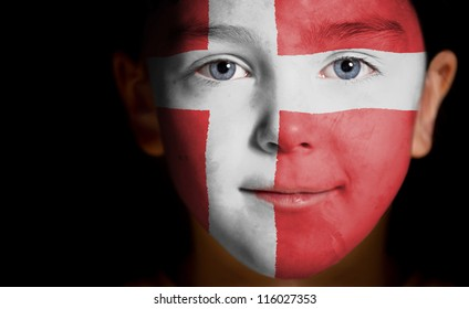 Portrait of a child with a painted Danish, flag, closeup
