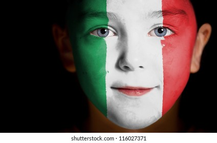 Portrait of a child with a painted Italian flag, closeup