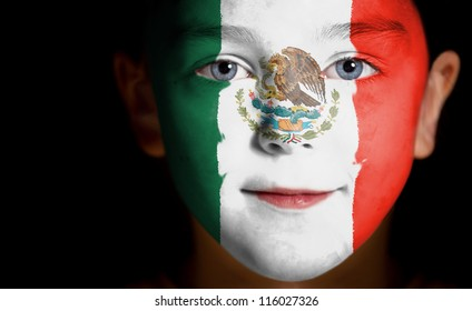 Portrait of a child with a painted Mexican flag, closeup