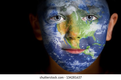 Portrait of a child with a painted North America. Elements of this image furnished by NASA