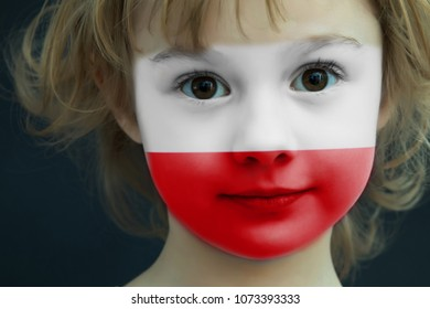 Portrait of a child with a painted Polish flag on her face, closeup.