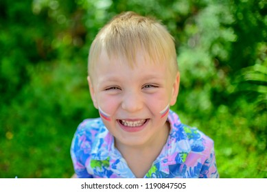 portrait оf a child with a painted russian flag closeup fan child supporting team