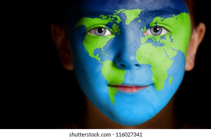 Portrait of a child with a painted world map, closeup