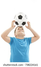 Portrait of a child playing with a soccer ball. Isolated on white background