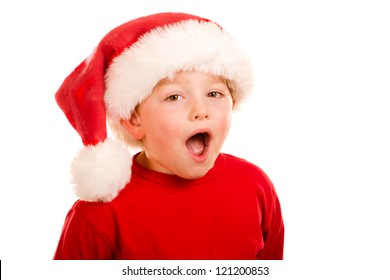 Portrait of child saying ho, ho, ho while wearing Santa hat isolated on white