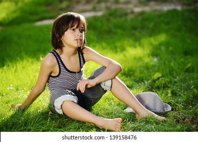 Portrait of a child sitting outdoor in a summer meadow