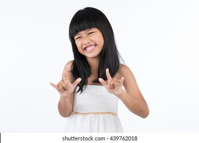 "Portrait of a child smiling using sign language to say ""love"" by hands on white background"