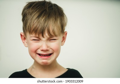 portrait of a child with tears in his eyes close-up