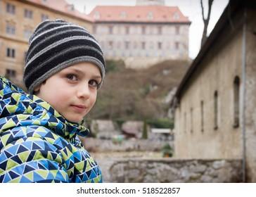 Portrait of a child tourist visiting historical castle in Europe, Cesky Krumlov