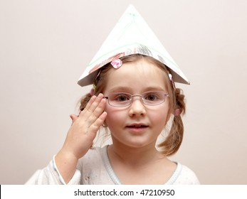 Portrait of a child wearing a paper hat