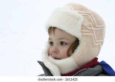 portrait of a child wearing winter fur cap isolated on white