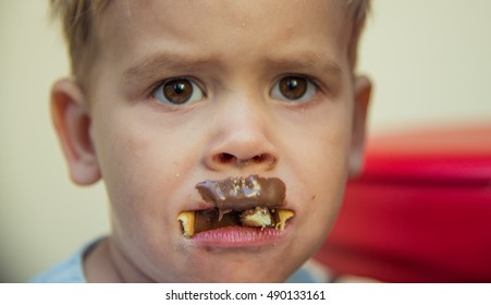 Portrait of a child who had eaten too much chocolate.