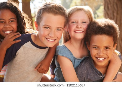 Portrait Of Children With Friends On Hiking Adventure In Woods