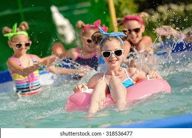 Portrait of children on the pool in summer. Noise visible at 100%.