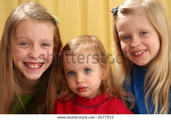 Portrait of children on yellow background