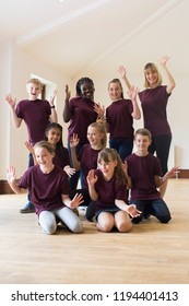 Portrait Of Children And Teacher Enjoying Drama Workshop Together