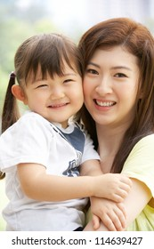 Portrait Of Chinese Mother With Daughter In Park