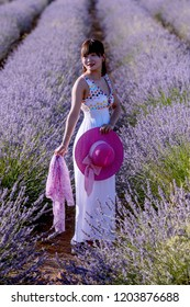 Portrait of a Chinese woman, in a lavender field