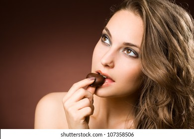 Portrait of a chocolate loving young brunette beauty