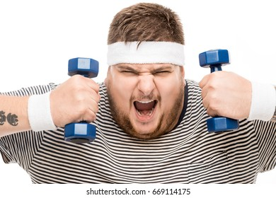 portrait of chubby caucasian man yelling while holding dumbbells isolated on white