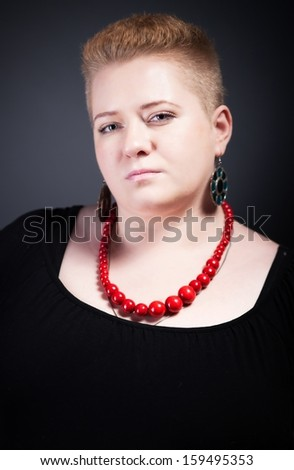 Portrait Of Chubby Woman With Short Hair And Red Beads