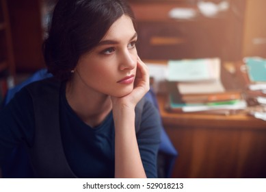 Portrait of clever young woman thinking alone