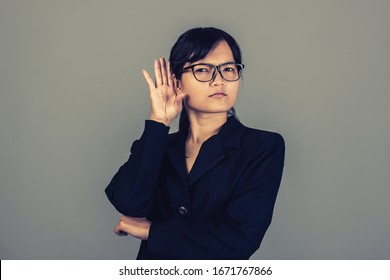 Portrait close up of beautiful asia young woman, on gray color background with copy space. Human face expressions, emotions feelings, body language, attitude perception,Life style stress concept