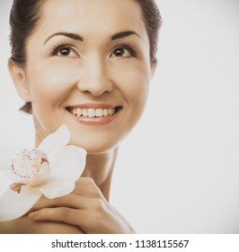 portrait close up of Beautiful woman face with  orchid flower, model is a asian beauty.