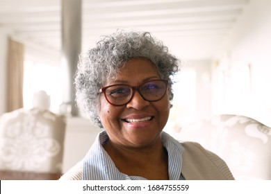 Portrait close up of happy senior African American woman wearing glasses smiling to camera. Family enjoying time at home, lifestyle concept