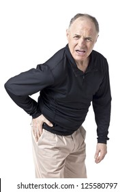 Portrait and close up image of a senior man having a hip pain against white background