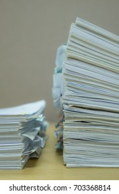 Portrait close up of two paper stacks