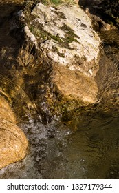 Portrait close up of water flowing over rocks in a river