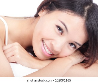portrait close up of woman smile face in relax pose at home on bed, model is a asian beauty