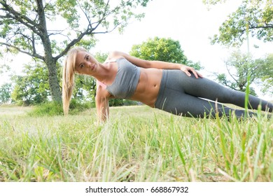 Portrait close up of young beautiful woman with perfect body and blonde hair , on green background summer nature.